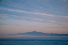 Mountain and mist. Mountain on top the mist stock images