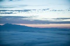 Mountain and mist. Mountain on top the mist stock photos