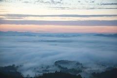 Mountain and mist. Mountain on top the mist stock photo