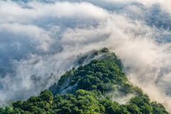 Mountain misty clouds aerial Stock Photography