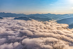 Mountain misty clouds aerial Stock Photos