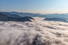 Mountain misty clouds aerial Stock Image