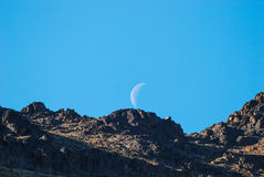 Mountain and the Moon. A mountain in Alaska with the moon above it Stock Photos