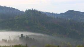 Mountain morning before sunrise. Fog moving time lapse stock footage