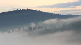 Mountain morning before sunrise. Fog moving time lapse stock video