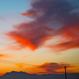 Mountain in morocco africa   current cables     and red sunrise Stock Image