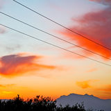 Mountain in morocco africa   current cables     and red sunrise Stock Photo
