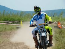 Mountain motocross race on dirt track in day time. Action sport stock photo