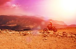Mountain motor biker riding on dusty road on Babadag, Mugla/Turkey stock photos