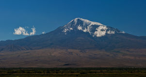 Mountain. Mount Ararat with a cloud at top Royalty Free Stock Photo