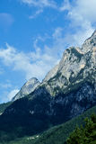 Mountain, mountainside, sky. Slope of mountain whith trees and forest Royalty Free Stock Photo