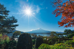 Mountain Mt. Fuji at garden and lake in japan with blue cloud sky and red maple tree Royalty Free Stock Photography