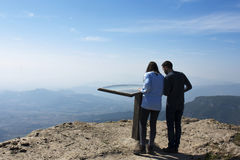 Mountain Mussara. Catalonia. Spain. 11/03/2017 Tourists enjoy a. Beautiful view into the interior of Mediterranean in the mountain Mussara viewpoint Royalty Free Stock Photos