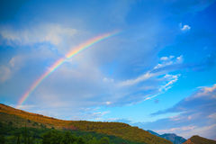 Mountain nature background with rainbow Stock Image