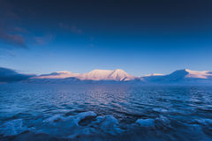 Mountain nature Svalbard Longyearbyen Svalbard Norway with blue sky sunny day wallpaper during sunset Royalty Free Stock Photo