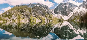 Mountain Near Body of Water during Cover With Snows Stock Photos