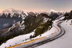 Mountain night with snow and ice on road Stock Photography