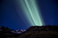 Mountain northern lights. Northern lights streaming over the mountains, Grundarfjordur, Iceland Stock Images