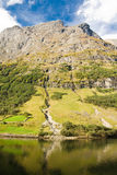 Mountain of norwegian fjord in Norway. Clouds and blue sky Royalty Free Stock Image