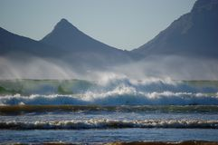 Mountain and the ocean with waves, South Africa, Cape Town, Atlantic Ocean, Lion`s Head royalty free stock photo