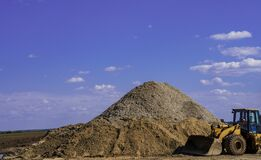Free Mountain Of Sand, And A Bulldozer Pushing. Royalty Free Stock Images - 217014189