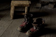 Handmade mountain boots. A pair of old handmade mountain shoes: soft light, low-key,Rembrandt light stock photos