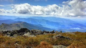 Mountain open space blue sky hiking royalty free stock photo