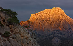 Mountain in orange light Royalty Free Stock Photos