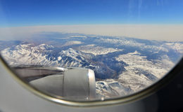 The mountain outside the airplane window. The mountain and aircraft engine outside the airplane window Stock Photo