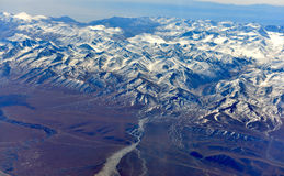 The mountain outside the airplane window. The TianShan mountain outside the airplane window Stock Photo