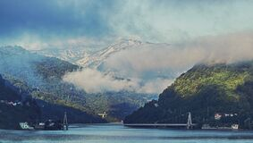 Mountain over Body of Water Royalty Free Stock Photo