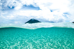Mountain over the sea view bunaken sulawesi indonesia underwater Royalty Free Stock Photo
