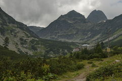 Mountain overgrown with coniferous forest, glade and rest-house toward Maliovitza peak in Rila   mountain Stock Photo
