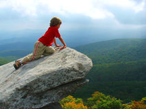 Mountain Overlook. Boy looking over cliff at views more than 4,000 ft. elevation Stock Images