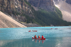 Mountain Paddlers. Canoes and paddlers on Lake Louise, Alberta stock photography