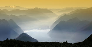Mountain panorama. Orange filter on the sky Stock Photos