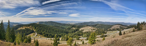 Mountain panorama. Panoramic view, mountain peaks, with blue sky and clouds Stock Photo