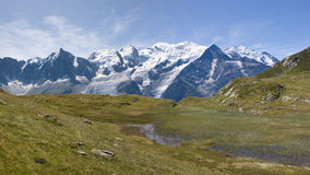 Mountain panorama. View toward the Mont Blanc, France,  over a meadow Royalty Free Stock Photography