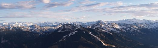 Mountain panorama. Showing the effects of global warming on the ski slopes of the Austrian Alps in January. Only a handful of runs can be seen. kept open with Stock Photography
