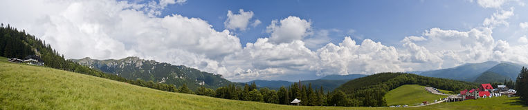 Mountain panorama. Panorama of Ciucas mountains ( Karpathians ) in Romania. Sunny day with some clouds on sky Royalty Free Stock Photos
