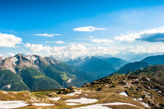 Mountain panorama. With clouds and blue sky from Fiescheralp, Wallis, Switzerland royalty free stock photography