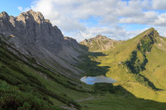 Mountain panorama with alpine hut Stock Photo