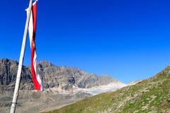 Mountain panorama with Austrian flag, Hohe Tauern Alps, Austria Stock Photography