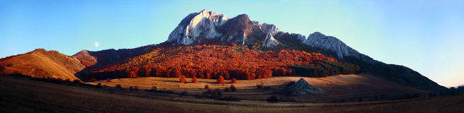 Mountain panorama in the autumn. A gorgeous mountain near the small village of Rimetea, Alba, Romania. Panoramic view taken in the evening as the colors Royalty Free Stock Photos