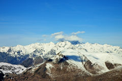 Mountain panorama with blue cloudy sky Stock Photo