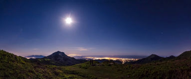 Mountain panorama, clear sky, full moon Royalty Free Stock Images