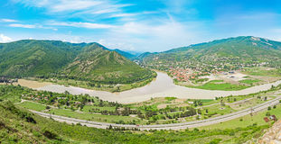 Mountain panorama with green field and blue sky. Summer landscape in mountains Stock Photography