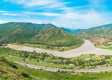 Mountain panorama with green field and blue sky. Summer landscape in mountains Royalty Free Stock Image