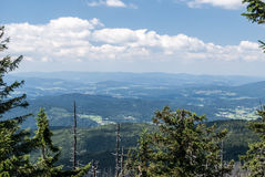 Mountain panorama from Grosser Rachel hill in Bavarian Forest. Mountains in Germany during summer day with blue sky and clouds Royalty Free Stock Image