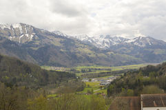 Mountain panorama in Gruyeres, switzerland. Beautiful snowy mountains and hills. Image taken from Gruyeres castle, Switzerland Royalty Free Stock Images